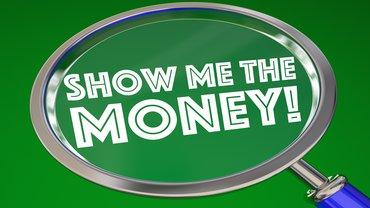 Geld Lupe Money Tarifverhandlung